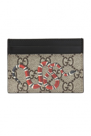 Card case with a snake motif od Gucci