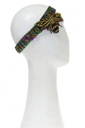 Appliqued patterned head band od Gucci