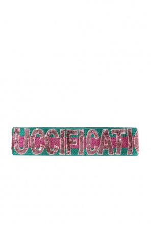 Sequinned lettering band od Gucci