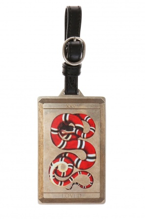 Luggage tag with snake motif od Gucci