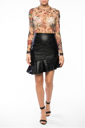 Body with tattoo motif od Dsquared2