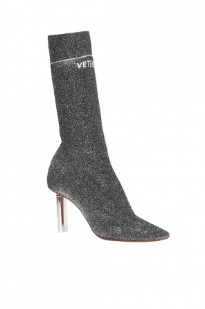 Heeled ankle boots with sock od Vetements