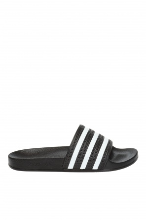 19eb1409a ... Slippers with an embossed logo od ADIDAS Originals
