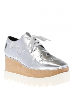 Elyse' shoes on the platform od Stella McCartney