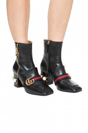 'web' heeled ankle boots od Gucci