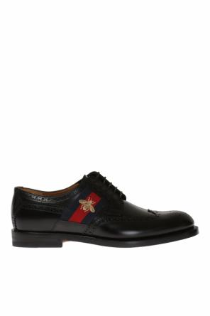 Perforated lace-up shoes od Gucci