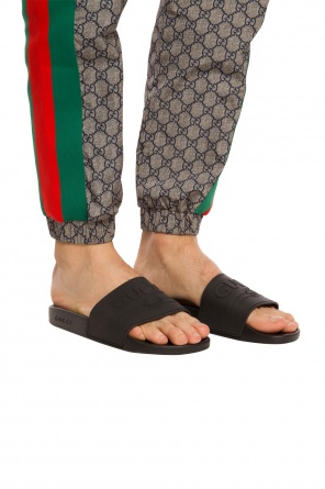 Logo-embossed slides od Gucci