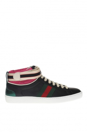 Ankle high sport shoes with a 'web' stripe od Gucci