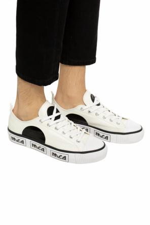 Sport shoes on the platform od McQ Alexander McQueen