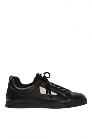 Sneakers with metal adornment od Fendi