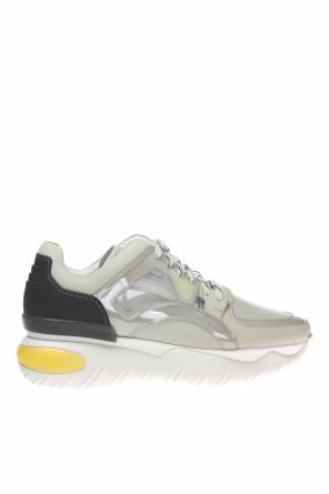 Sport shoes with an application od Fendi