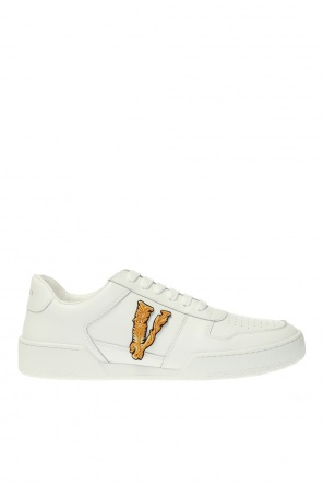 Sneakers with perforations od Versace