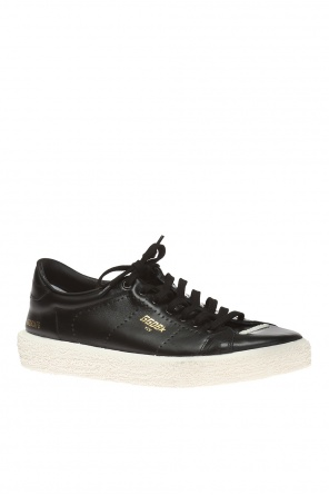 Branded sneakers od Golden Goose