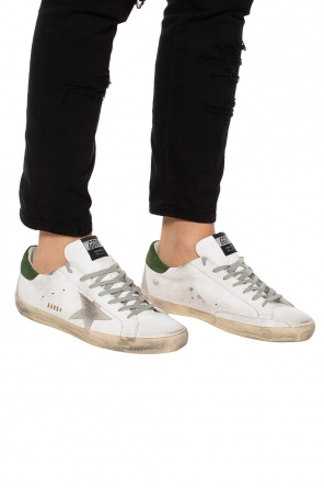 'superstar' sneakers with a worn effect od Golden Goose
