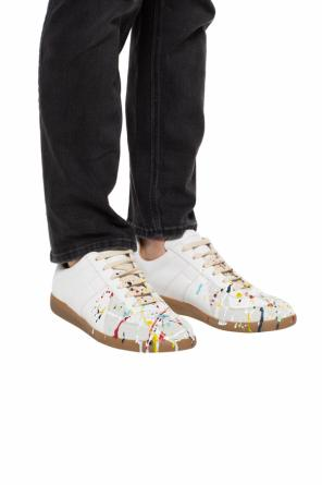 Paint-splattered sneakers od Maison Margiela