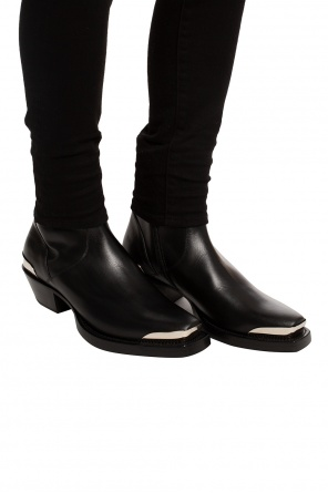 Ankle boots with metal appliques od Vetements