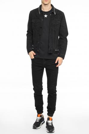 Distressed denim jacket with zippers od Givenchy