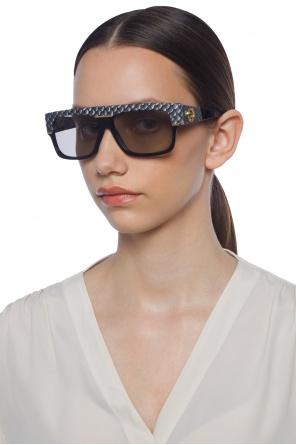 945a5fcc1e2 Sunglasses with logo od Gucci ...