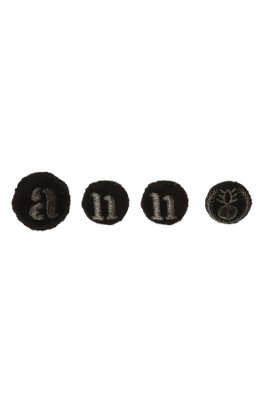 Set of logo brooches od Ann Demeulemeester