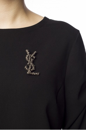 Logo-shaped brooch od Saint Laurent
