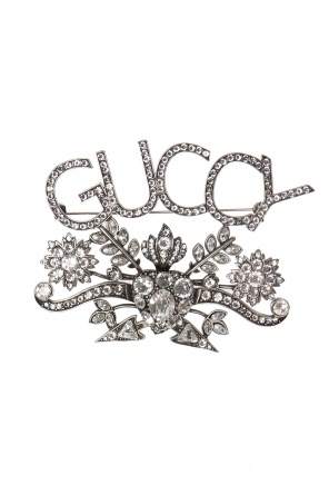 Logo-shaped brooch od Gucci