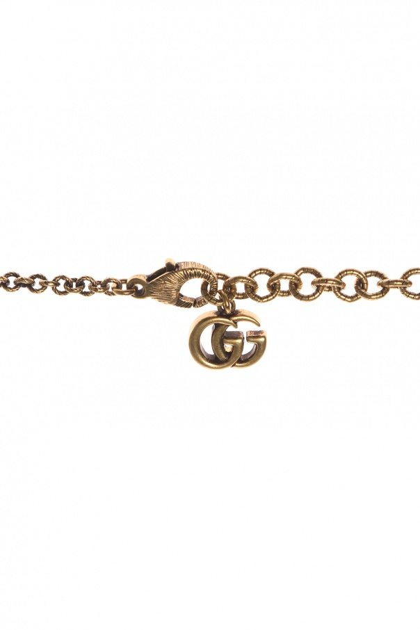 Cross motif necklace od Gucci