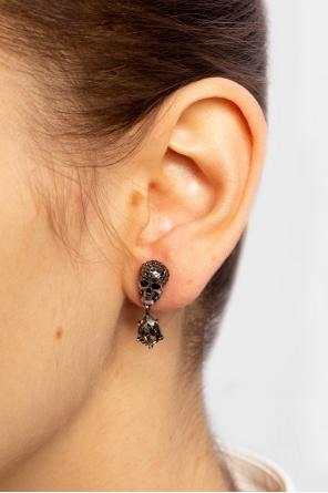 Brass skull earrings od Alexander McQueen