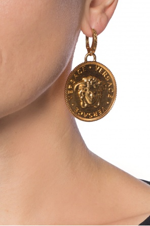 Medusa head earrings od Versace