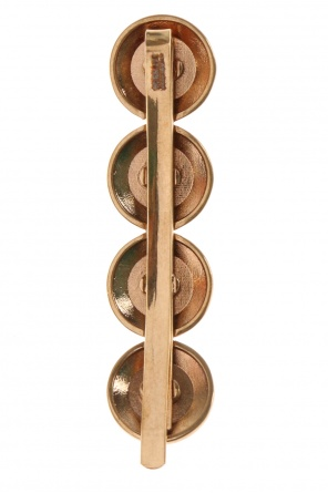 Adorned hair pin od Versace