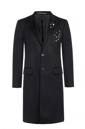 Coat with a metal application od Givenchy