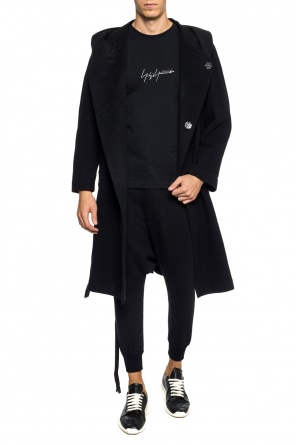 Hooded double-breasted coat od Yohji Yamamoto