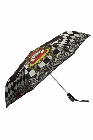 Folded umbrella with a bear motif and a logo od Moschino