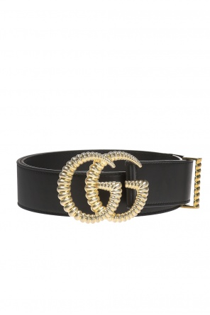 Belt with a decorative buckle od Gucci