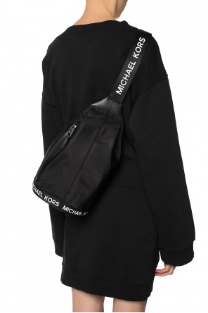 A one-shoulder backpack with a logo od Michael Kors