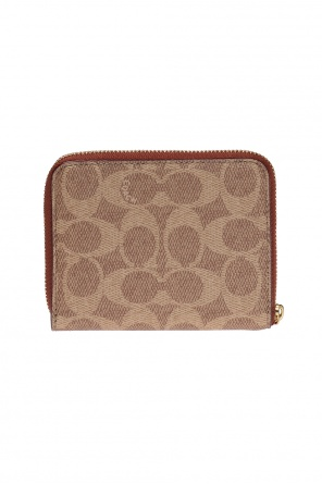 Wallet with sewn on applications od Coach