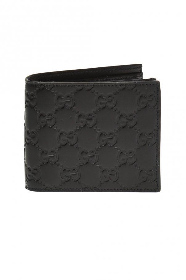 e2591792ca78 Embossed bi-fold wallet Gucci - Vitkac shop online