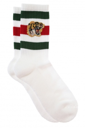 Black panther head socks od Gucci
