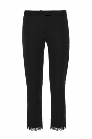 Lace-trimmed trousers od Ann Demeulemeester