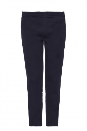 Velvet side-stripe trousers od Alexander McQueen