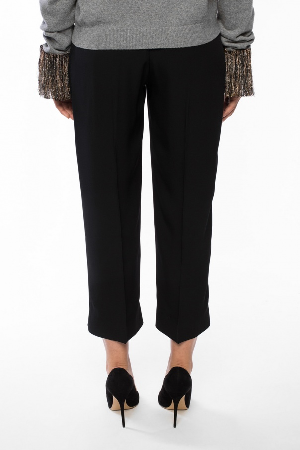 Trousers with decorative charm od Christopher Kane