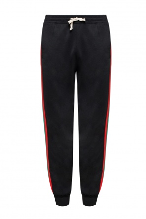 Sweatpants with 'web' stripes od Gucci