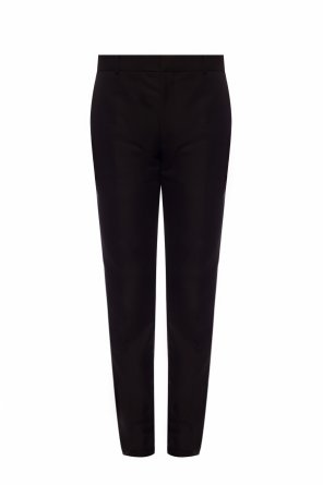 Creased trousers od Alexander McQueen