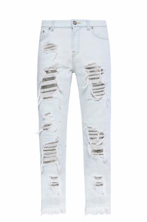 Distressed jeans with frayed cuffs od Versace Versus