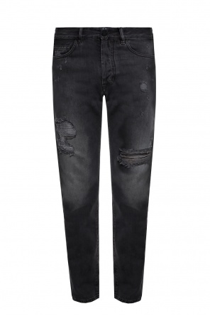 Stonewashed jeans with rips od Marcelo Burlon