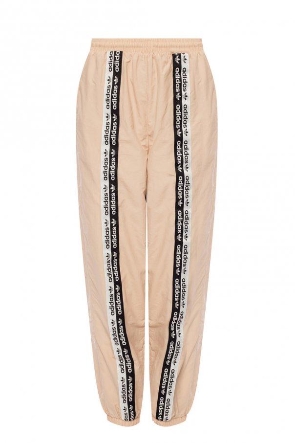 przed Sprzedaż niezawodna jakość świetne ceny Spodnie dresowe z paskami z logo ADIDAS Originals - sklep ...