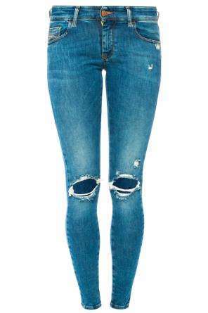 Distressed tapered jeans od Diesel