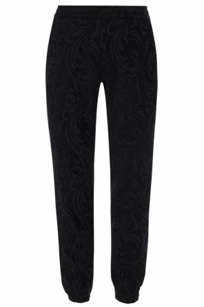 Baroque pattern trousers od Versace