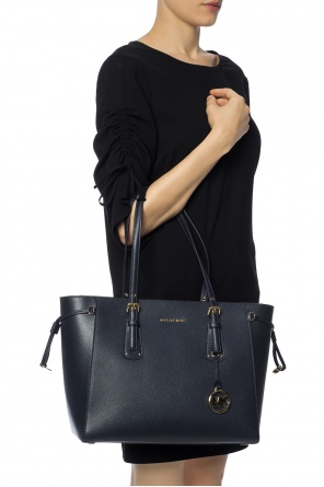 Voyager' shoulder bag with a logo and a pendant od Michael Kors