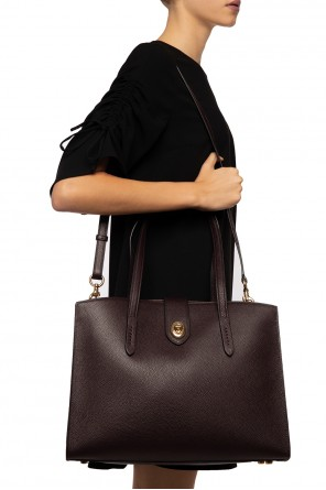 Shoulder bag with a decorative clasp od Coach