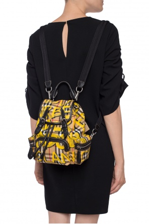 Backpack with a plaid motif and a print od Burberry
